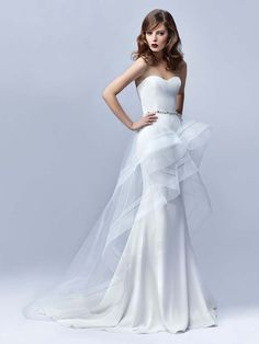 A sleek wedding gown with detachable skirt.