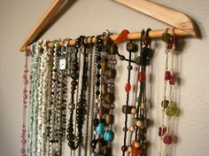 i organize my necklaces the same way. it saves ample space and doesn't get tangled.