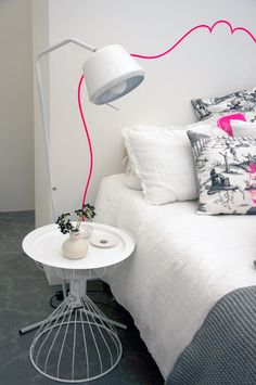 Love the neon pink faux headboard and the cushions from la cerise sur le gateau.