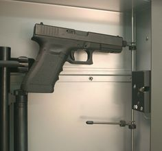 Handgun Tree! Installed in our Recessed-in-Wall Gun Vaults. Vertically adjustable with a 45 degree horizontal rotation. Rubber-coated, non-marring rods fit into barrel for easy storage and quick, grab-n-go access. Custom design found only in the gun vaults at www.ConcealedGunVaults.com