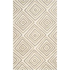 This contemporary rug with an abstract diamond design is hand-tufted in India, and it comes in two soft color palettes.