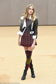 Miss Delevingne: Cara shunned her usual tomboy style on Monday at the Burberry A/W15 presentation