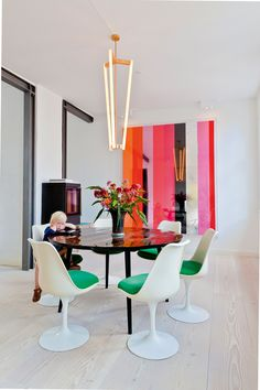 colorful, beautiful dining room with a spectacular pendant light.