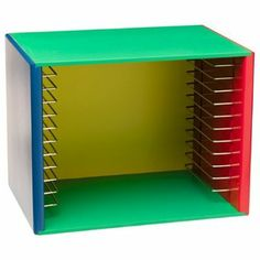 wood puzzle storage system | This bold and bright wooden puzzle storage unit holds up to 12 ...