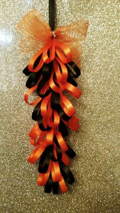 Orange and black loopy braid for homecoming mums. Designed by Crafty bug