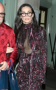 Off she goes: The Charlie Angles: Full Throttle star wore large black rimmed glasses and seemed somewhat bleary-eyed as she called it a night Demi Moore