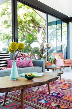 30 Patio Designs with Modern Furniture Interiordesignshome.com Modern patio furniture colorful pattern rug and pillows large windows for natural light
