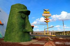 Giant head in Walapai.Lovingly named Giganticus Headicus, this green head is reminiscent of the statues on Easter Island, just without the beach. It is located on the northeast corner of Antares Road and Route 66.