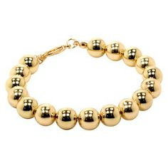 I saw this at Target today and almost left with it... love. ::: Fashion Bead Bracelet - Gold