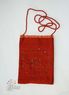 http://www.afday.com/collections/bags/products/silk-evening-bag-1  Rs 300