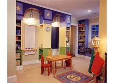 """interesting playroom storage - note the storage built into the sides of the center """"pillar"""" to hold art supplies"""