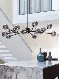 RRP $895 Orion 15 Light Pendant in Black/Smoke able to be hung close to the ceiling using a 150mm rod.
