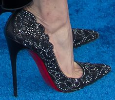 "Emmy wears the studded scallop ""Top Vague"" pumps from Christian Louboutin"
