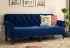 Parker offers sumptuous comfort in luxurious footprint. Distinguished by set-back rolled arms, nail head detailing and blue color fabric print, this sofa is sure to add charm into your home. #fabricsofa #fabricsofas #fabricsofaset #fabricsofahome #fabricsofa3seater
