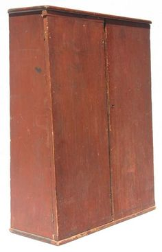 You can spot a piece from the 1700's from across the room! Look at this great rare form 18thC cant back cupboard. Love the original red paint!