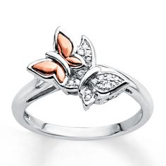 A beautiful flight of fancy, two delicate butterflies of contrasting colors perch atop this ring. Crafted in sterling silver and 10K rose gold, the ring is  sprinkled with diamonds totaling 1/20 carat in weight. Diamond Total Carat Weight may range from .04 - .06 carats.