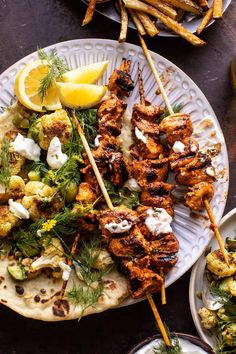 Bringing you all some springtime vibes with this Lebanese Chicken with Charred Lemon Cauliflower and Garlic Yogurt.a fun switch-up from ordinary chicken! Lebanese Chicken, Grilled Chicken Skewers, Herb Salad, Toasted Pumpkin Seeds, Half Baked Harvest, Mediterranean Recipes, Bon Appetit, Chicken Recipes, Good Food