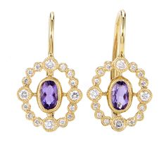 Achieving an appearance of spellbinding feminine luxury, these fabulous earrings brilliantly combine the 18K yellow gold radiance with the tender appe...