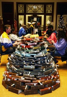 Strands of lights decorate this book tree in the lobby of Granite City's downtown library. When the library was renovated, administrative assistant Kari Fischer came up with the idea to use old books to make the book tree.