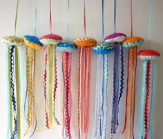 jellyfish craft. I used felt and a hot glue gun instead of sewing. And I used ricrac and tulle, but the tulle was a huge mistake - it's like velcro and keeps sticking to itself and the felt. Oh well. Work to the wise...use ribbon. :)