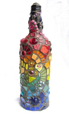 Rainbow Bottle Mosaic    Second mosaic bottle, this time in rainbow colours... I could post tons of pictures because it looks different from every angle!