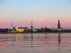 Moon over the Old Town in Riga, Latvia...  Visit us on Facebook:  https://www.facebook.com/groups/imagesfromallovertheworld