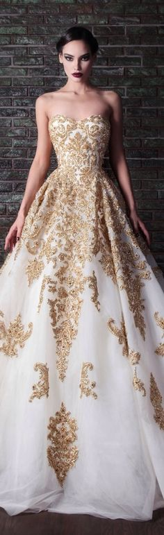 Strapless sweetheart neckline A line ball gown with organza over lay and gold detailing