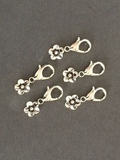Crochet Stitch Markers  silver flower by TheKnottedLife on Etsy