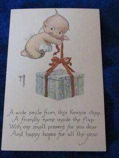 http://www.ebay.com/itm/Kewpie-Post-card-tying-the-bow-wearing-apron-/181927050614?hash=item2a5bb27d76:g:hvMAAOSw5VFWGIId