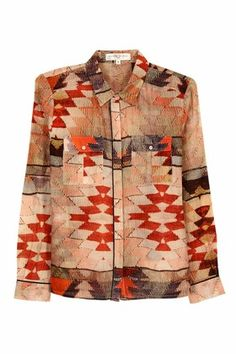 Valentine Gauthier steers an office wardrobe staple into outdoor terrain with her Kilim button-down shirt. We love the contradiction between the gauzy fabric, pearlescent buttons and prim collar, and the rugged attitude conveyed by the Southwest-inspired digital print.