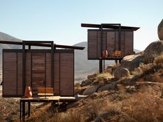 Located in Mexico's Wine Country in Valle de Guadalupe, Baja California, Endémico Resguardo Silvestre is an impressive eco hotel high up on a hill overlooking the valley below. Mini Cabins, Travel Hotel, Guest Cabin, Luxury Cabin, Baja California, Bungalows, Coastal Homes, Prefab, Modern House Design