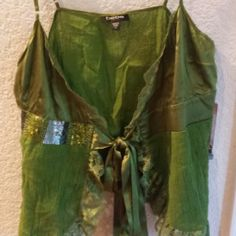 Peridot Green Medium Bebe top This is a green Bebe top that ties in front. You would wear a camisole under it.It was worn a couple of times bebe Tops