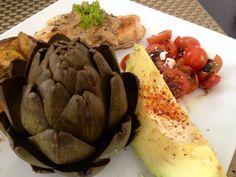Healthy lunch chicken, artichoke, tomato and avocado