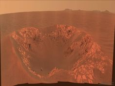 Intrepid Crater on Mars from Opportunity - The robotic rover Opportunity sometimes passes small craters on Mars. Pictured here in 2010 is Intrepid Crater a 20-meter across impact basin slightly larger than Nereus Crater that Opportunity had chanced across previously. The featured image is in approximately true color but horizontally compressed to accommodate a wide angle panorama. Intrepid Crater was named after the lunar module Intrepid that carried Apollo 12 astronauts to Earth's Moon 49…