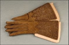 pair of men's embroidered gauntlet gloves, circa 1600