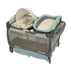 Pack n' Play with changing table and space for baby carrier..good idea!