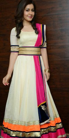 Actress Rashi Khanna in Off White Anarkali SuitTollywood actress Rashi Khanna is looking lovely in designer Anarkali suit. Round neck Anarkali dress has tri color patch border at the bottom. Floo...