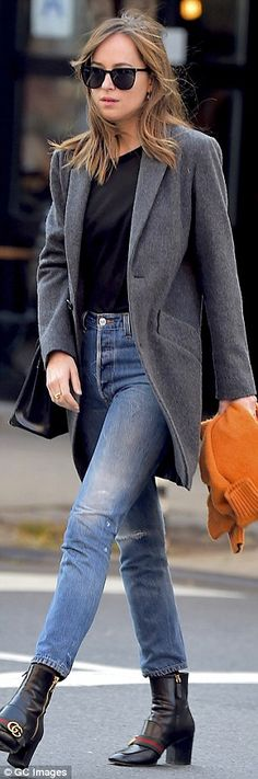 Added extras! Johnson had a black purse slung over her shoulder and carried a tangerine orange sweater in her hand