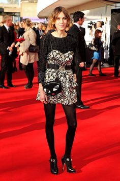 Alexa Chung with the Cat clutch bag