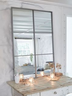 Made from distressed antique silver metal, this loft style window mirror has 6…