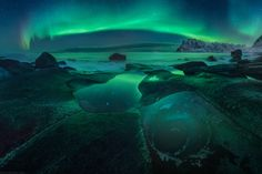 Avocado aurora - Panorama of the famous Uttakleiv eye at Lofoten.