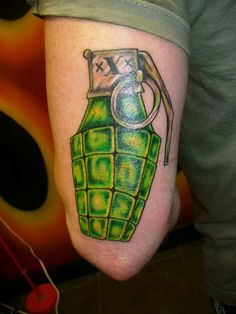 Grenade tattoo by Bob Bachman at Permanent Images.