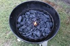 Add charcoal and a piece of firestarter. LIght the firestarter