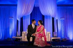 This Indian bride and groom celebrate their marriage at their wedding reception.