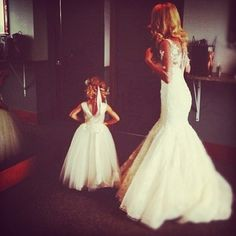 Flower girl and bride getting ready together! Would love this pic