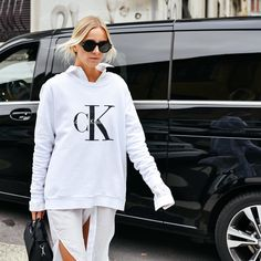 """Calvin Klein on Instagram: """"White out. Stylist + blogger @celineaagaard_ attended yesterday's #mfw press presentation wearing the Calvin Klein Jeans logo sweatshirt + the Sofie mini duffle. #mycalvins Available now at calvinklein.com [EU]"""""""