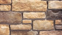 """Limestone is a tailored stone that conveys a traditional formality. It is a hand-dressed, chisel-cut textured stone roughhewn into a rectangular ashlar profile. This stone is medium in scale and ranges from 2"""" to 8"""" in height and 4"""" to 17"""" in length, and has an average stone size of 6"""" by 12"""". The distinctive color blends of Eldorado Limestone are versatile palettes ranging from lighter soft creams and golden umbers to light coffee, sienna rusts, and more deep moss greens."""