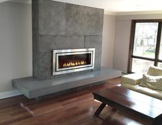 contemporary concrete fireplace hearth, cantilevered