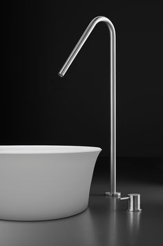 Italian-made stainless steel high sink faucet in satin finish, designed for offset applications with vessel sinks.