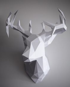 My DIY 3D paper reindeer head!!! Check out a tutorial over on my website www.ashleyfreemandesign.com